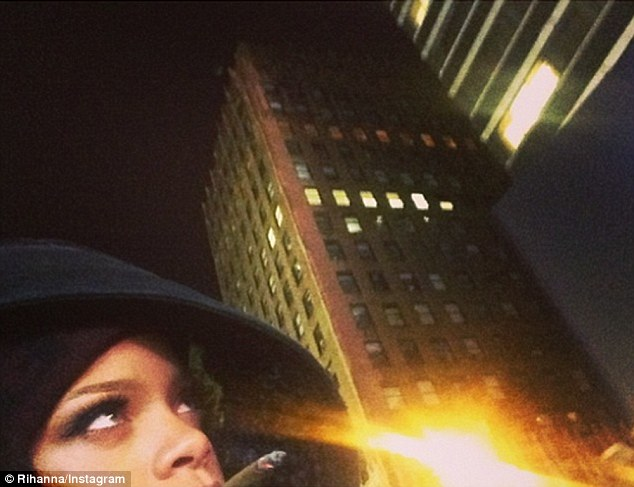 Up in smoke: The Rude Boy singer posted an image of her with a suspicious cigarette in her mouth on Sunday