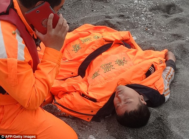 Ordeal: Tseng Lien-fa, 42, miraculously survived by clinging on to a floating coffin lid