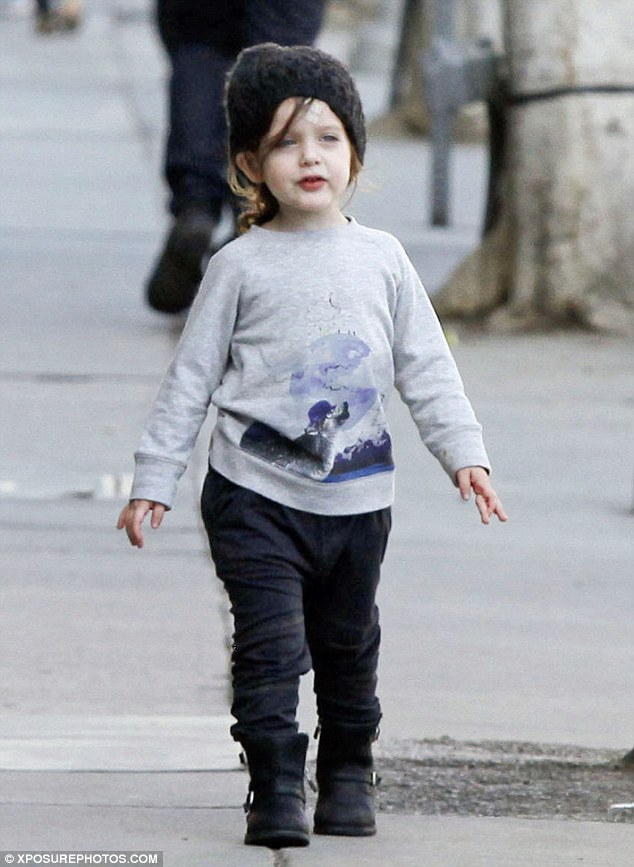 Styling at a young age: Skyler, who turns three in March, looked quite adorable and stylish for a toddler in a gray sweater with a scene from nature printed on it, black pants, black boots, and a black knit beanie