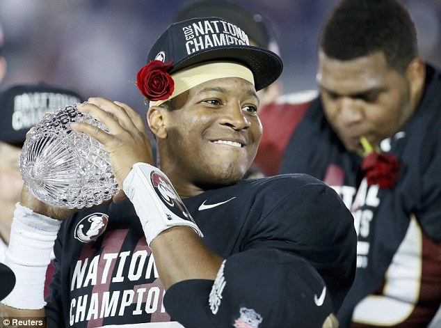 Victory: Florida Seminoles quarterback Jameis Winston holds the championship trophy after they defeated the Auburn Tigers to win the BCS Championship football game in Pasadena, California January 6, 2014