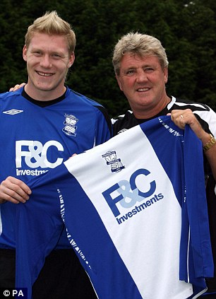 Premier class: O'Connor with Steve Bruce after signing for Birmingham