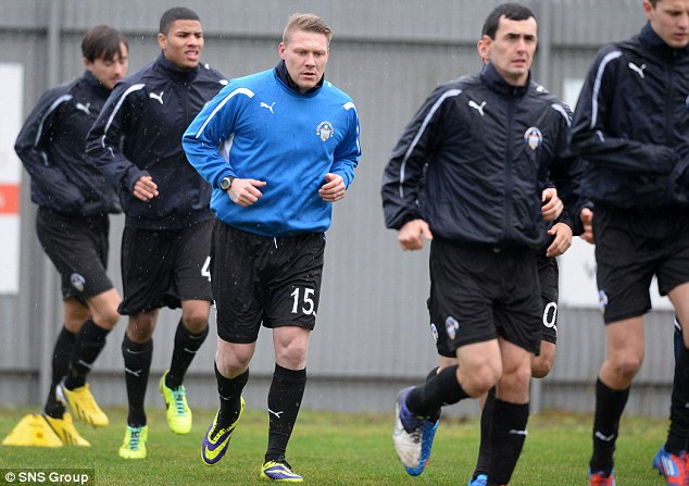 Ready to do his bit: O'Connor takes part in the Morton's warm-up