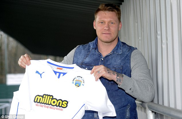 Time to shine: O'Connor is all smiles after signing for Morton