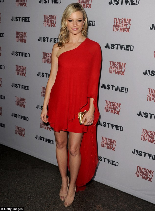 Lady in red! Amy Smart steals the spotlight in her off-the-shoulder bright red frock