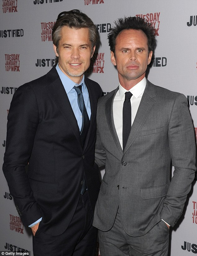 Smize boys: Timothy Olyphant  and Walton Goggins look dapper in their suits for the season five premiere which was shown in the US last night