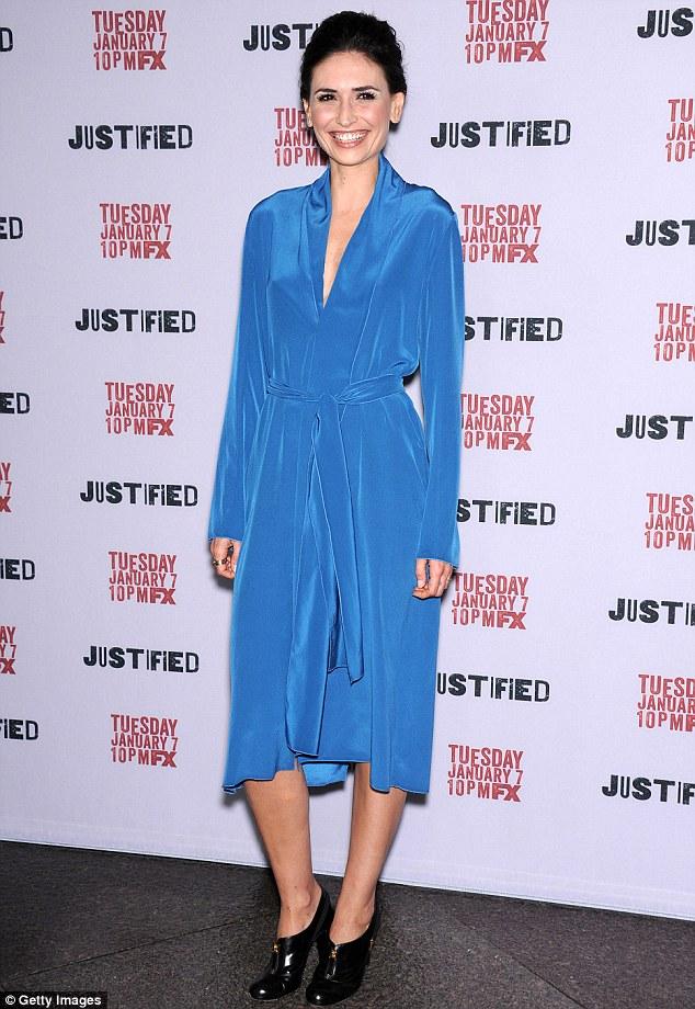 Got the blues? Karolina Wydra wore a draping wraparound dress of bright blue for the red carpet