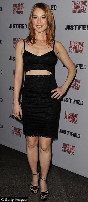 Alicia Witt also decided to go with a midriff for her red carpet look