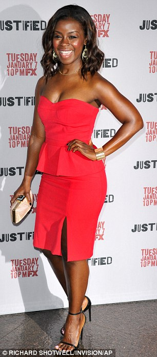 Howdy pardner: Olyphant's onscreen colleague Erica Tazel looked gorgeous in vibrant red