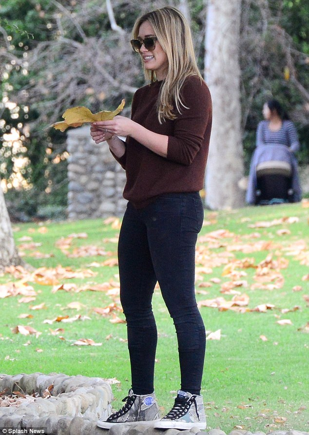 Autumnal bliss: The actress looked pleased with her gift, as the pair enjoyed a romantic stroll