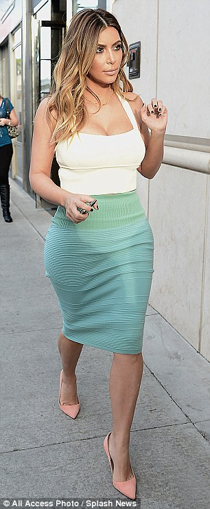 Hot mama! The Keeping Up With The Kardashians star showcased her incredible post-pregnancy body in a mint green pencil skirt and cream crop top as she shopped in Beverly Hills, California, on Monday