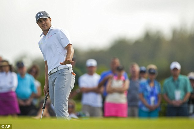 So close: Jordan Spieth watches his putt on the 10th hole of his final round. He finished one stroke behind Johnson