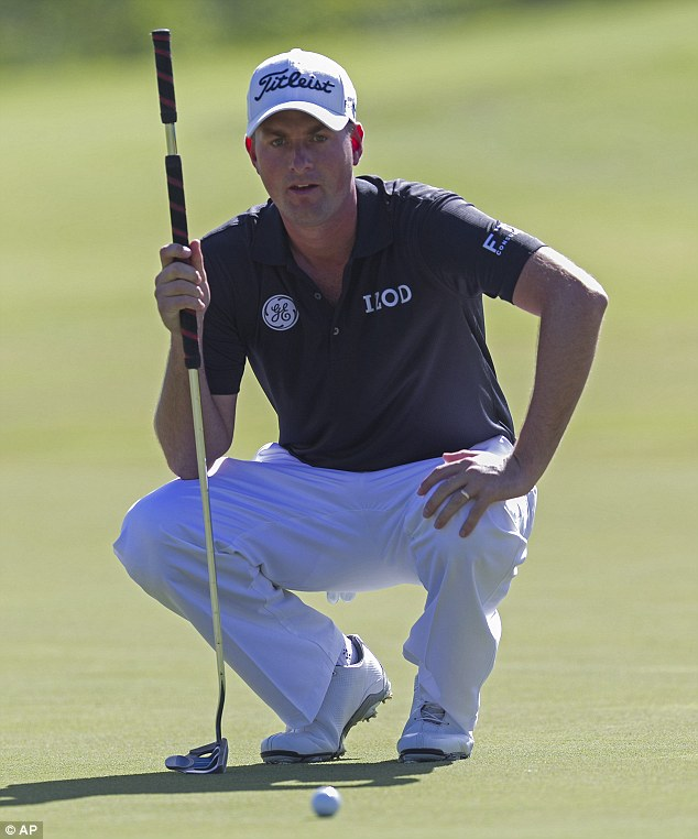 Judgements: Webb Simpson, who tied third with Streelman, measures a putt