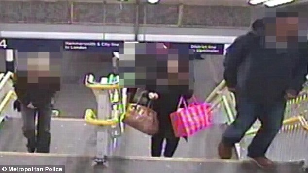 This still shows Naomi Oni holding bags at Barking station in east London before she was attacked