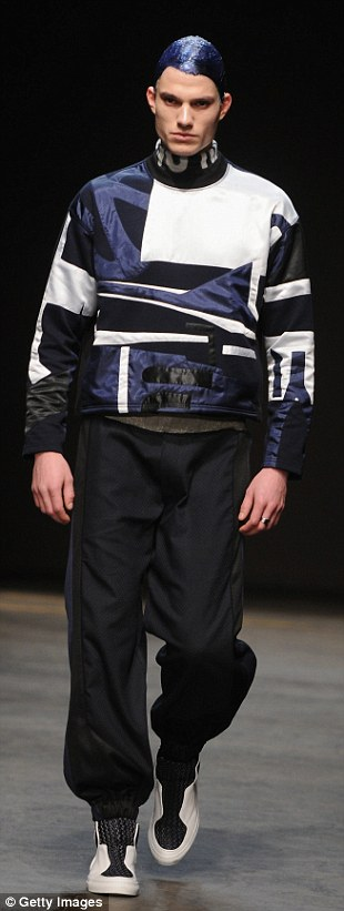 Feeling blue: It was standout streetwear with mid-length raglan sleeve coats and electric blue hair at James Long's show