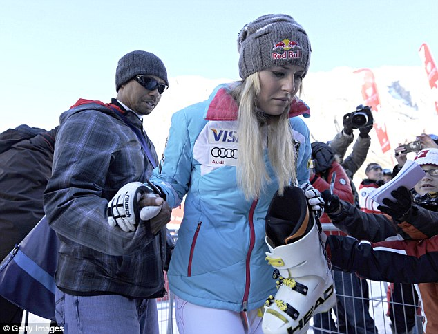 Helping hand: Tiger Woods (right) comes to the aid of his girlfriend Lindsey Vonn last month