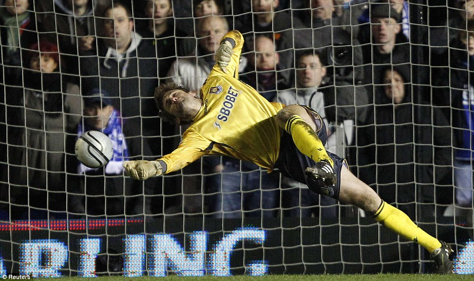 Through the fingertips: Robert Green can't keep out Craig Gardner during the League Cup semi-final when West Ham lost to Birmingham in 2011