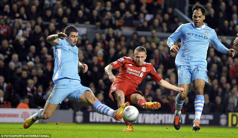 Defeated by the champions: Aleksander Kolarov was powerless to stop Manchester City losing 3-2 on aggregate to Liverpool in the 2011/12 League Cup semi-final
