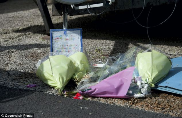 In memory: Flowers are left at the scene of the horrific attack, which happened in the early hours of August 4