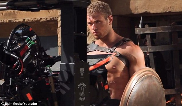 All eyes on him: Kellan has never been fitter in scenes from his upcoming action film