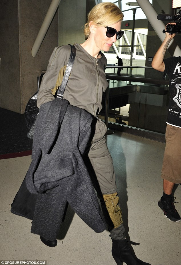 Airport fashionista: Cate Blanchett arrived at LAX in a parachute gear-inspired jumpsuit and over-sized shades