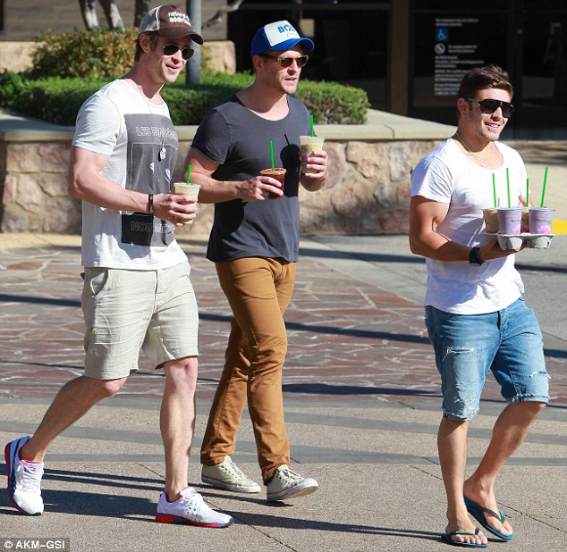 He's got a treat too: Chris and his pals treated themselves to a smoothie after the shopping trip