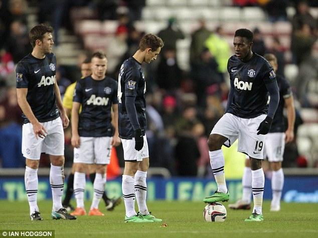 Downbeat: Adnan Januzaj and Danny Welbeck look gloomy as they have to kick-off again