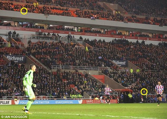 Close proximity: Sir Alex Ferguson (circled top) has his eye on the game, and David Moyes (circled bottom)