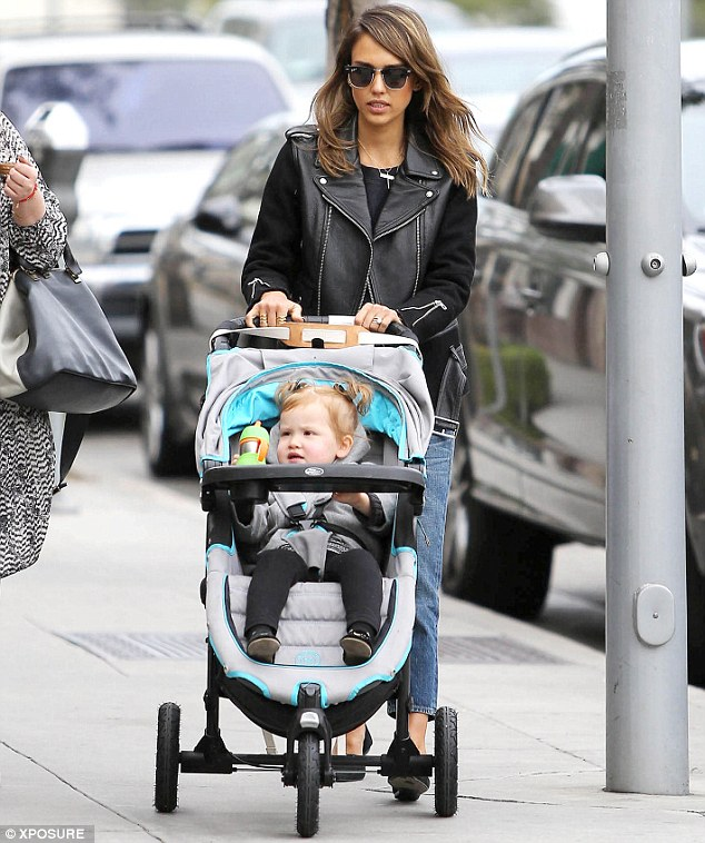Yummy mummy: Jessica Alba looked chic in a leather jacket, jeans and black pumps as she took her daughter Haven out in Los Angeles on Tuesday
