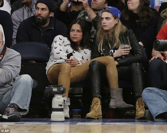 Basketball fan: Cara attended her second game - this time with actress Michelle