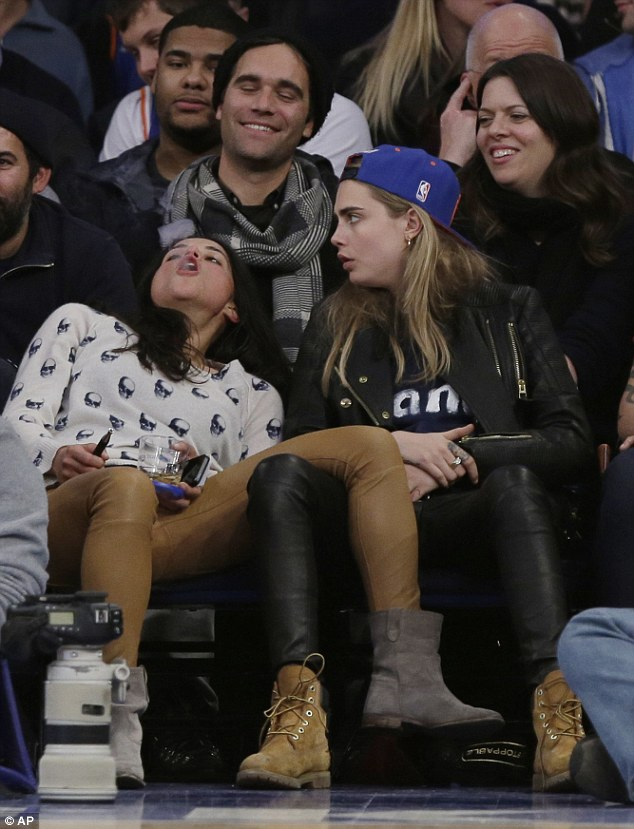 Sporty: She wore a black leather jacket, black leather pants, brown lace up boots, and expressed her allegiance to her team with a bright blue and orange New York Knicks cap on her head, worn backwards