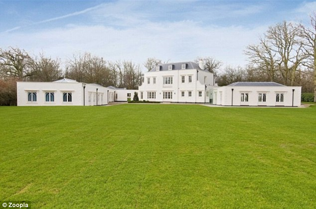 Rear view: The view of the property from the garden shows the extent of the sprawling mansion