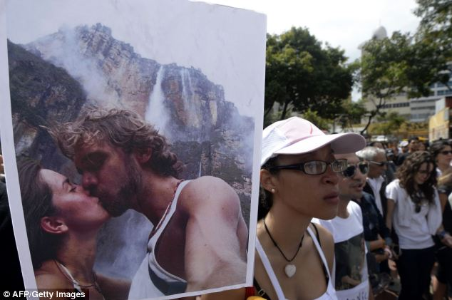 People gather in a demonstration in Caracas, the Venezuelan capital, to protest over the death of Monica Spear
