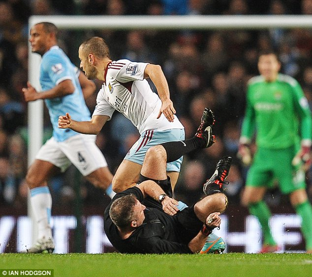 Flattened: Referee Jonathan Moss takes a tumble during semi-final clash