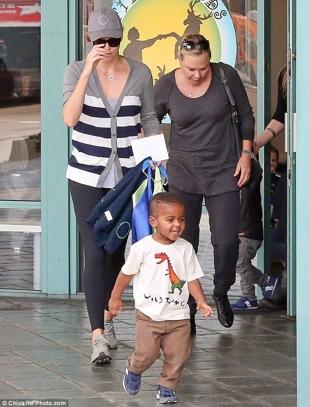 Family fun: Charlize Theron - who has recently been linked to Sean Penn - proved the main man in her life is still very much her adorable son Jackson as they enjoyed some quality time together on Wednesday