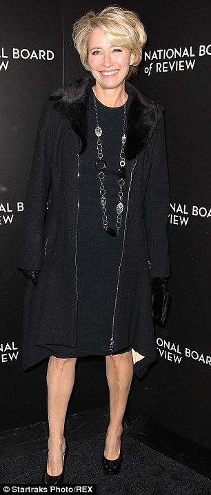 LBD: The 54-year-old opted for a chic black shift dress and fur-collared coat