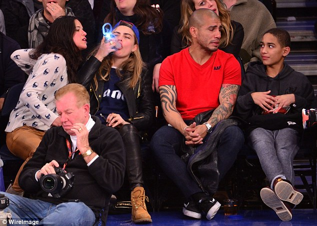 Awkward: The two males seated next to Cara and Michelle exchange bewildered looks