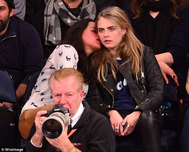 Sweet nothings: Michelle seemed to be trying to tell Cara something as she watched the game