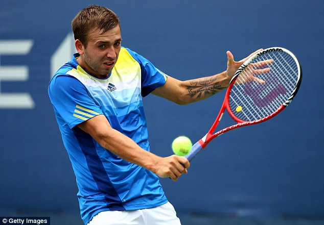 Still going: Dan Evans, pictured here in action during last year's US Open, is through to the next stage of qualifying for the Australian Open after beating Huang Liang-chi
