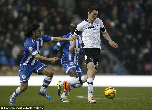 Commanding: Michael Keane has been solid at the back for Derby