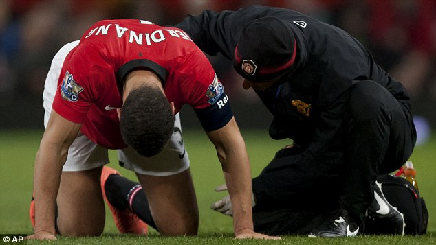 Down and out: Rio Ferdinand was injured against Swansea and his career could be coming to an end
