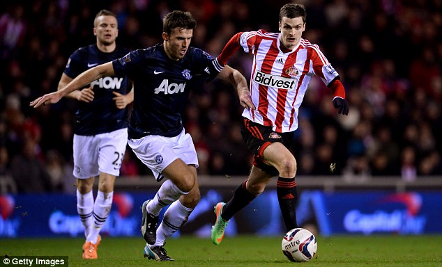 Passing him by: Michael Carrick, one of United's better players, struggles to get to grips with Adam Johnson