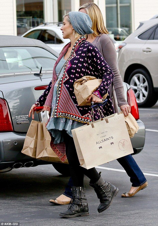 Treats: Elsa left the store carrying a large bag from All Saints