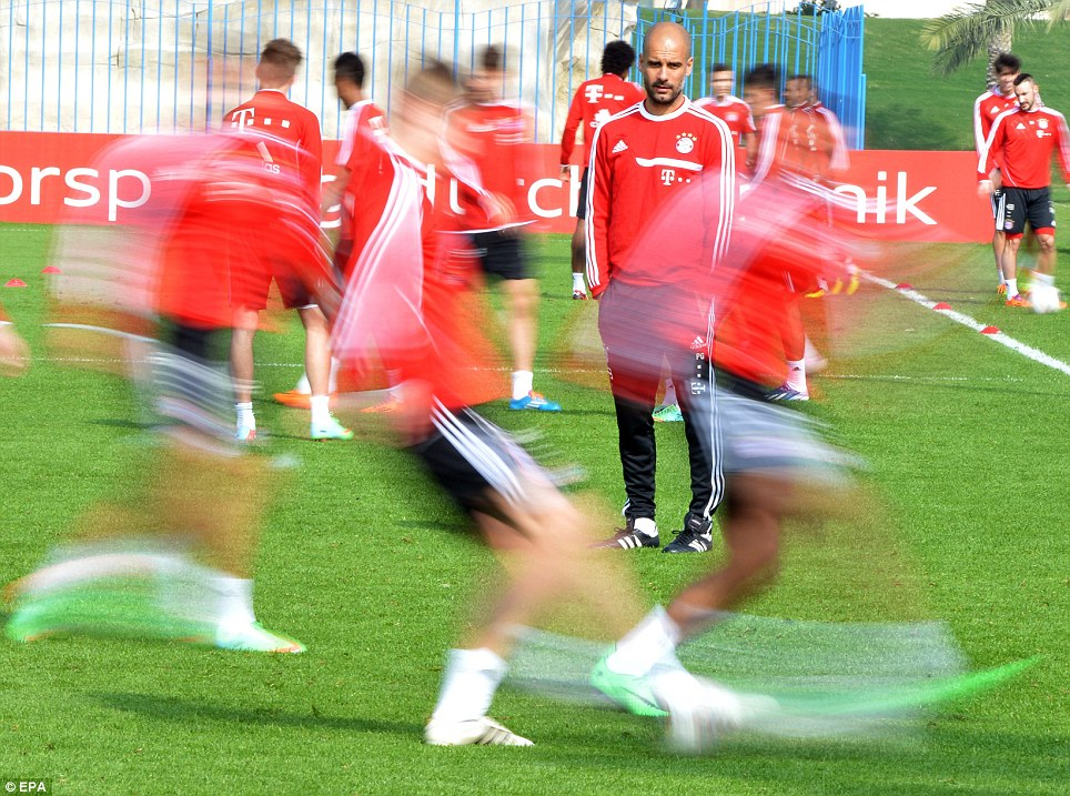 Blurred lines: Bayern Munich's head coach Pep Guardiola (centre) leads his team's training session during the club's winter break in Doha, Qatar