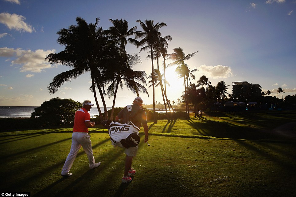 Sweet sunset: Daniel Chopra of Sweden plays a hole during a practice round prior to the Sony Open in Hawaii at Waialae Country Club in Honolulu, Hawaii