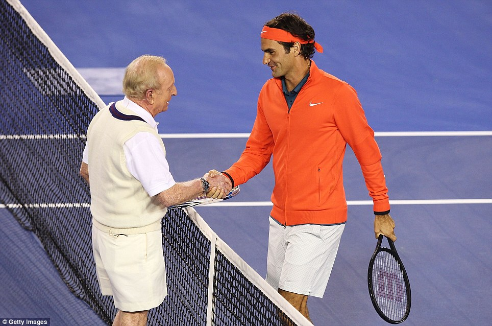 Old and new: Roger Federer of Switzerland (right) and Australian tennis legend Rod Laver shake hands during a charity match at Melbourne Park, Australia