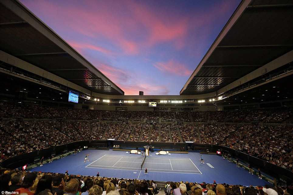 Red sky at night: Switzerland's Roger Federer (left) and France's Jo-Wilfried Tsonga play a match at Rod Laver Arena during a charity tennis event in Melbourne