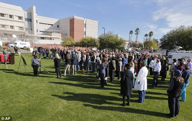 Remembering three years ago: A crowd assembles on the lawn outside University of Arizona Medical Center during a ceremony for the third anniversary of the Tucson shootings on Wednesday