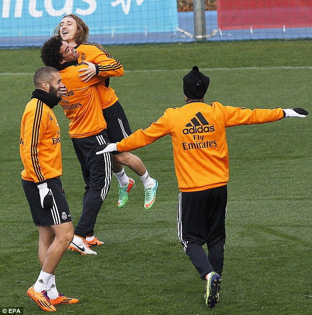 Hugs all round: Madrid players (L-R) Karim Benzema, Pepe and Luka Modric joke around during training