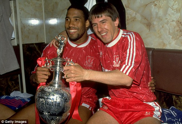 Victorious: John Barnes and Peter Beardsley of Liverpool celebrate with the Division One trophy in 1990
