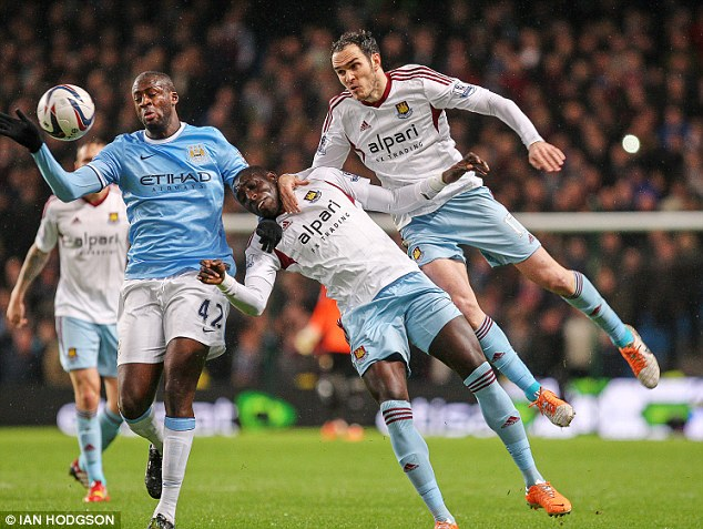 Gulf in class: City's Yaya Toure (left) wins the ball from Mohamed Diame (centre) and Joey O' Brien